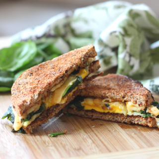 Egg and Cheese with Crispy Spinach on Ezikiel